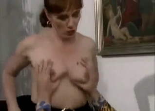 Redhead in a black skirt awkwardly seducing her brother