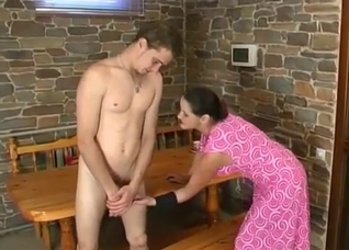 Stockings-wearing brunette fucks her hung son