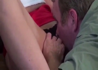 Ponytailed brunette drops to her knees to service dad