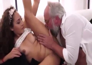 Curly-haired beauty enjoying her father's huge cock