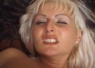 Tanned blonde fucks her family on a couch