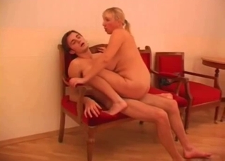 Blond-haired MILF lovingly blows her son
